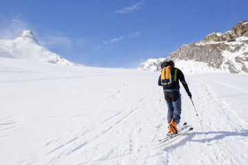 skier going up of a mountain