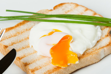 Poached Egg On Toast With Chives. White Plate