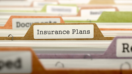 File Folder Labeled as Insurance Plans in Multicolor Archive. Closeup View. Blurred Image. 3D Render.