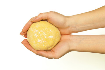 Hands holding a finished clean dough