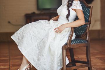 Beautiful bride enjoying wedding day. Happy newlyweds. Bridal picture.