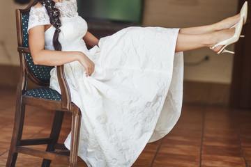 Young beautiful bride enjoying wedding day. Happy newlyweds. Bridal picture.