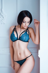 Perfect, sexy body, belly and breast of young woman wearing seductive lingerie. Beautiful hot female in underware posing on sensual way