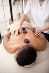 Young man relaxed in spa center