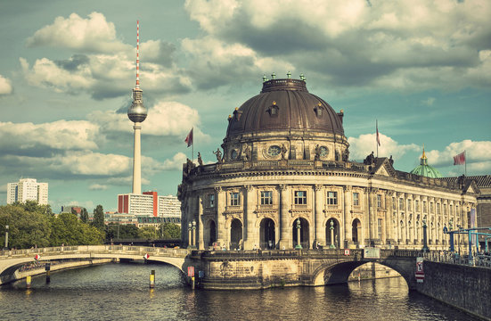 Bode Museum located on Museum Island (Museumsinsel) with river Spree and TV Tower in background, Berlin Mitte, Germany, Europe, vintage filtered style