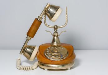 Elegant vintage telephone covered in brown leather