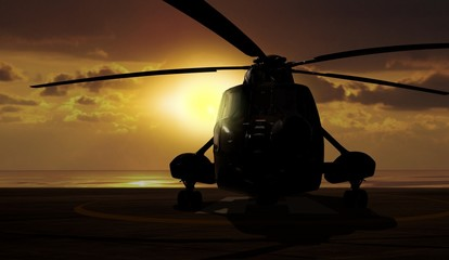 Military helicopter on carrier ship at sunset