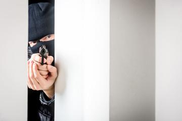 Aiming murderer with a gun