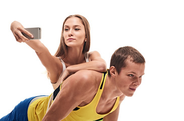 man doing push ups and woman selfie