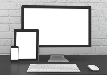 Responsive mockup screen. Monitor, tablet, phone on table in office.