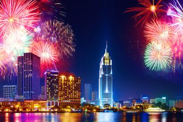 Celebration. Skyline with fireworks light up sky over business district in Ho Chi Minh City ( Saigon ), Vietnam. Beautiful night view cityscape, urban landscape. Holidays, celebrating New Year.