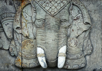 Elephant god statue on public temple wall in Thailand