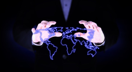 two hand covered the glowing world map.