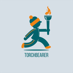 Torchbearer. The winter Olympic games. The athlete runs with the