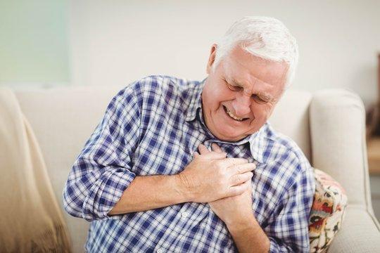 Senior man getting chest pain
