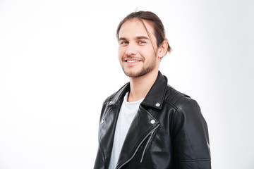 Portrait of handsome smiling young man in black leather jacket