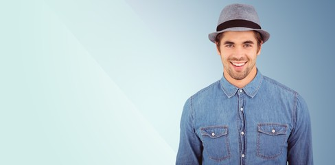 Composite image of portrait of happy hipster wearing hat
