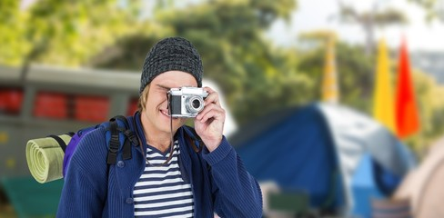 Composite image of backpacker hipster taking pictures with a camera