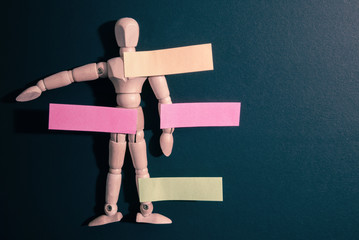 Paper, Post-it, note the wooden puppet - stock image