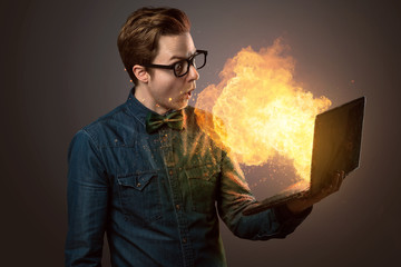Nerdy Guy with an exploding Notebook