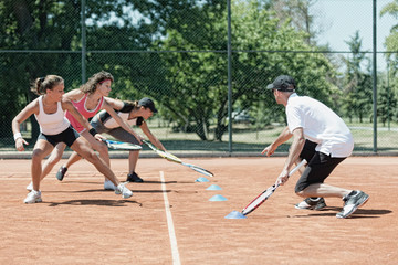Touching markers, cardio tennis fitness class
