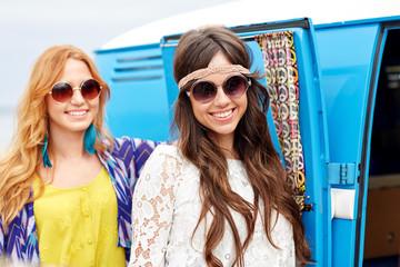 smiling young hippie women over minivan car