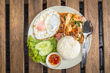 Rice topped with stir-fried combination of pork, chicken, squid,