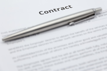 Close up of business contract document with pen