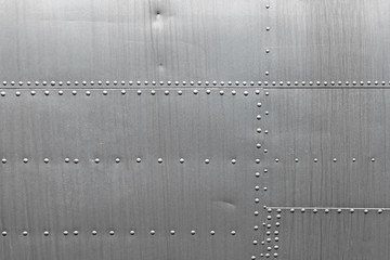 Abstract metallic background. Silver metal texture with rivets.