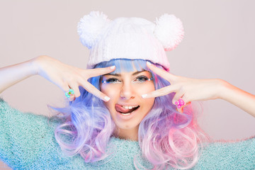 Modern young woman with pastel pink and blue hair and beanie
