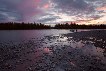 Clouds in the sunset light over the river. Moma River. Yakutia. Russia.