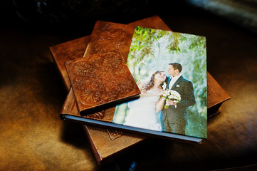 Brown leather wedding book and album