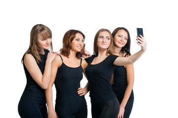 Group of girls making selfi isolated at white