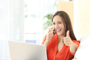 Happy entrepreneur working with thumbs up