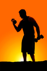 silhouette of man curling a weight