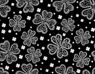 Beautiful vector seamless pattern with clover leaves - symbol of the St. Patrick's day