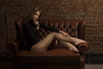 Pretty blonde woman sitting on the couch