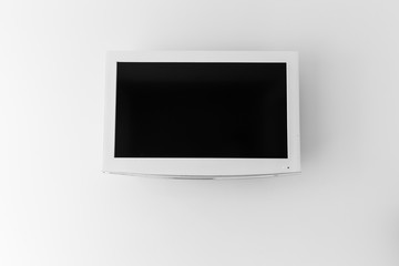 Plasma TV on the wall of the room