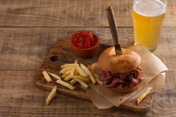 Tasty steak burger on a wooden board