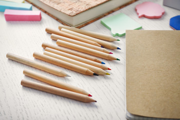 Notebooks with stationery on a white table