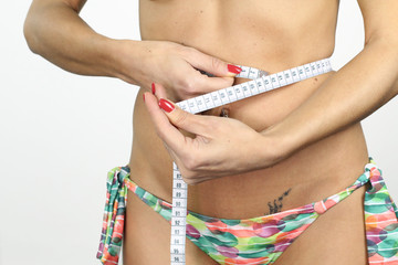 diet - woman measuring her belly