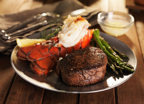 steak and lobster surf & turf meal with asparagus