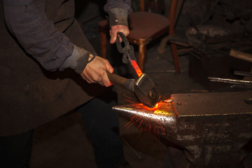 Blacksmith forfing hot iron