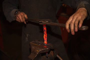 Blacksmith working with vise