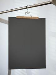 Trouser hanger with black paper sheet. 3d rendering