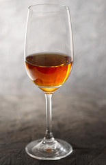 Glass of amontilliado sherry on wooden plank