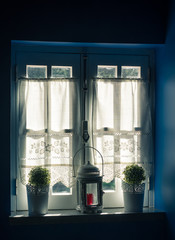 Vintage Window and Curtain with Flower Pots and Old Lamp