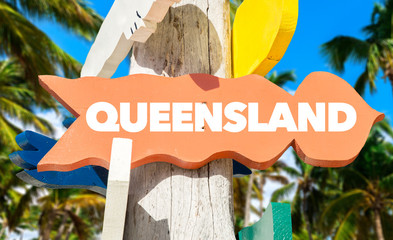 Queensland welcome sign with palm trees