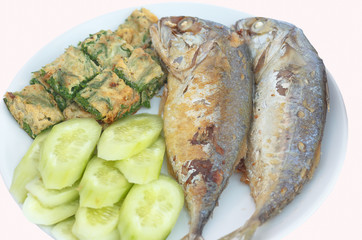 Fried Mackerel with  Acacia Pennata Omelet and Cucumber.Local food of Thai,isolated with clipping path.
