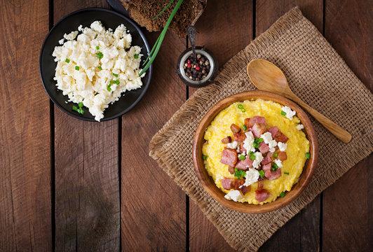 Banosh - Ukrainian Hutsul meal (maize porridge) with bacon, cracklings and cheese. Top view